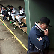 Seattle Mariners manager Lou Piniella smokes a cigarette during the first game of the ALCS against the New York Yankees on October 17, 2001 in Seattle, Washington.