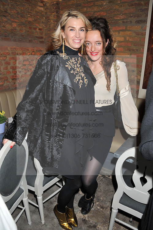 Left to right, ASSIA WEBSTER and ALICE TEMPERLEY at an evening of cheesey culinary delights & champagne hosted by Alex James, Yasmin Mills and Elaine Foran held at Aubaine, 31 Dover Street, London on 20th March 2012.