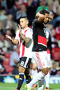 Nottingham Forest striker, on loan from Benfica, Hildeberto Pereira (17)  holding head with Brentford defender Nico Yennaris (8)  clapping during the EFL Sky Bet Championship match between Brentford and Nottingham Forest at Griffin Park, London, England on 16 August 2016. Photo by Matthew Redman.