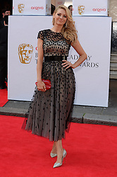 Tess Daly arrives for the BAFTA TV Awards at the Theatre Royal, London, United Kingdom. Sunday, 18th May 2014. Picture by Andrew Parsons / i-Images