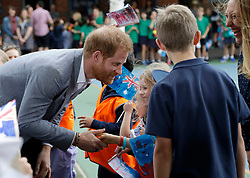 The Duke of Sussex shakes hands with a pupil during a visit to Albert Park Primary School in Melbourne, on the third day of the royal couple's visit to Australia.