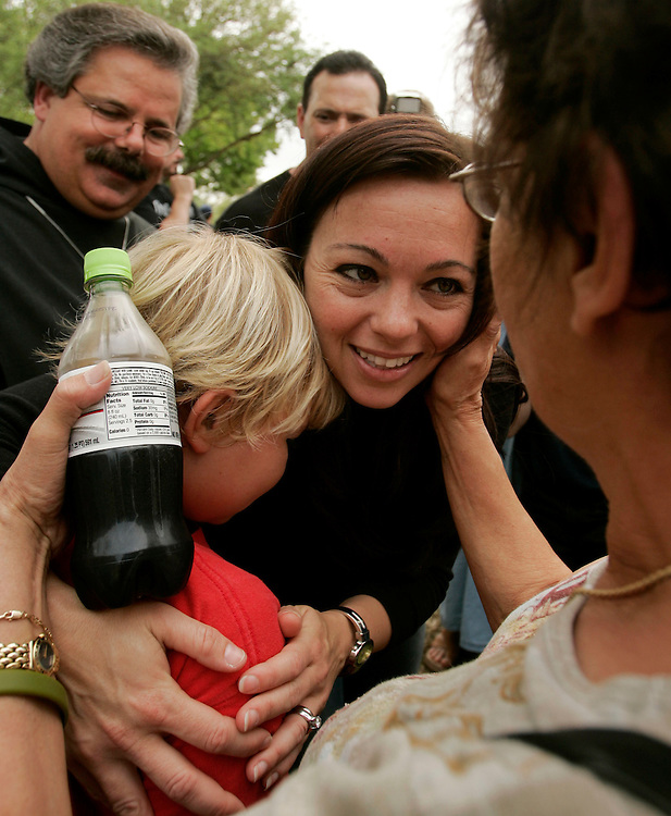 Suzanne Vitadamo (C), sister of the brain damaged Terri Schiavo, hugs a supporter outside the front entrance to the Woodside Hospice on March 24, 2005 in Pinellas Park, Florida. REUTERS/Scott Audette