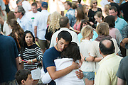Parents and students embrace outside of St. Aloysius Church. <br />
