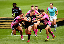 Tom Griffiths of Saracens hands off Tom Hendrickson of Exeter Chiefs and gets past Sal M'Boge of Exeter Chiefs Chiefs - Mandatory by-line: Robbie Stephenson/JMP - 29/07/2017 - RUGBY - Franklin's Gardens - Northampton, England - Exeter Chiefs v Saracens - Singha Premiership Rugby 7s
