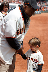 SAN FRANCISCO, CA - APRIL 26:  Former San Francisco Giants center fielder Willie Mays hands a baseball to Cody Harrington of Oakland, CA on the field before the game against the Cleveland Indians at AT&T Park on April 26, 2014 in San Francisco, California. The San Francisco Giants defeated the Cleveland Indians 5-3.  (Photo by Jason O. Watson/Getty Images) *** Local Caption *** Willie Mays; Cody Harrington