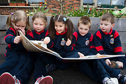 No fee for Repro: .Senior Infant pupils at St. Philips National School, Mountview, Dublin 15, Samanta Novikovaite, Eve Goeghegan, Mirela Uncu, Scott Flanagan and Sam Duffy are pictured going enjoying reading time at as they welcomed students of ITB's (Institute of Technology Blanchardstown), Early Childhood Care and Education course to deliver their Story Sack presentations as part of the Creative Group Facilitation module in conjunction with Fingal County Library. The project aimed at getting young children excited about reading. Picture Andres Poveda