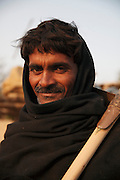 A portrait of Bilal Bheel, age 40,  who was enslaved for 7 years for borrowing US$670.<br /> <br /> Following the release of the Global Slavery Index by the Walk Free Foundation Pakistan is ranked 3rd worse in the world behind India and China. The Asian Development Bank estimates some 1.8 million people are slaves in Pakistan yet other estimates reach up to 4 million people, most of which toil year after year in brick kilns or sugar cane plantations. Their stories are the same; they have no-where to turn so they borrow money from a land-owner for a medical emergency or marriage dowry. The landlords pay in return for work, their labour supposed to be taken off the amount borrowed. Yet after years of no salary incredibly their amount owed is often quadrupled, the excuse being the amount they cost to feed! Many are chained, abused, raped and even killed.<br /> <br /> For years they had no where to run, no one to help but now a small local NGO called the Green Development Rural Organisation (GDRO) works to free bonded-slaves by using the law against their captives. Yet, often freed slaves end up right back where they were or risk being hunted by the landowner and forced to return. So GRDO started building villages so slaves who escape or are freed have somewhere safe to go. It now has two, whose names translate from Urdu as 'Village of the Freed' and 'Village of the Courageous', and is working on a 3rd. The land is bought and allocated to freed slave families where they can built a house and start again. Without such help the vicious cycle would continue.
