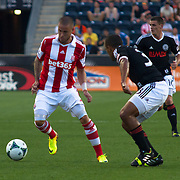 Stoke City F.C. Midfielder MICHAEL KIGHTLY (21) attempts to pass the ball to Stoke City F.C. Striker KENWYNE JONES (9) in the first half a MLS regular season international friendly match against the Philadelphia Union Tuesday, July. 30, 2013 at PPL Park in Chester PA.