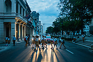 High school students cross the street in the early morning to get to their school. Downtown Havana, Cuba
