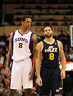 Feb. 15, 2011; Phoenix, AZ, USA; Phoenix Suns forward Channing Frye (8) reacts on the court alongside Utah Jazz guard Deron Williams (8) at the US Airways Center. Mandatory Credit: Jennifer Stewart-US PRESSWIRE