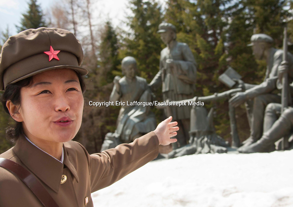 "PAEKTU, LAND OF NORTH KOREAN LEGENDS<br /> <br /> Mount Paektu volcano is considered a holy place for North Koreans. It is deemed the place of origin for them. The country's founding father Kim Il- Sung commanded anti-Japanese guerrilla in the 50's from a secret camp in this place.<br /> North Korea says his son Kim Jong-il was born there in 1942. He was actually born in Siberia, where his father had taken refuge from Japanese troops.<br /> The dear Leaders are said to have a ""mount Paektu bloodline ». A famous slogan says: « Let us all turn out in the general offensive to hasten final victory in the revolutionary spirit of Paektu! »<br /> A new probelm may erupt: when North Korea tests a nuclear weapon, specialists say the energy could trigger a volcanic...eruption in Paektu. That could be a huge disaster, killing thousands in North Korea and on the chinese side too.<br /> <br /> Photo shows:  The local guide was very happy to meet foreigners as very few go there: too far, too cold, too expensive.<br /> ©Eric Lafforgue/Exclusivepix Media"