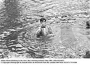 Julian Alison drinking in the river. May morning Oxford.1 May 1983. Film 83234f17<br />