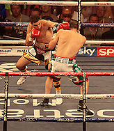 Picture by Richard Gould/Focus Images Ltd +44 7855 403186<br /> 13/07/2013<br /> Tommy Coyle (gold &amp; black) and Derry Mathews fight for the vacant Commonwealth Lightweight title at Craven Park, Hull.