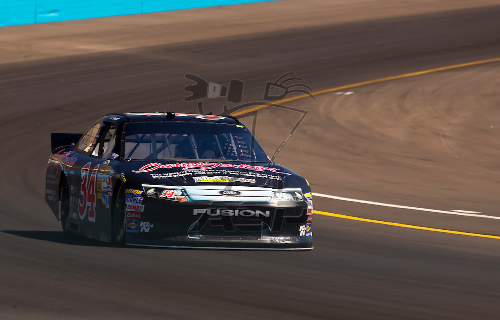 AVONDALE, AZ - MAR 03, 2012:  David Ragan (34) brings his NASCAR Sprint Cup car through turn 4 during qualifying for the Subway Fresh Fit 500 race at the Phoenix International Raceway in Avondale, AZ.