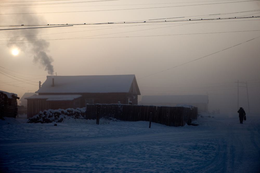Afternoon sun and housing at the Oymyakon village. The area is extremely cold during the winter. Two towns by the highway, Tomtor and Oymyakon, both claim the coldest inhabited place on earth (often referred to as -71.2°C, but might be -67.7°C) outside of Antarctica. The average temperature in Oymyakon in January is -42°C (daily maximum) and -50°C (daily minimum). The images had been made during an outside temperature in between -50°C up to -55°C. Oymyakon, Oimjakon, Yakutia, Jakutien, Russian Federation, Russia, RUS, 20.01.2010