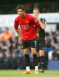 LONDON, ENGLAND - Saturday, February 2, 2008: Manchester United's Cristiano Ronaldo is dejected against Tottenham Hotspur as referee Mark Clattenburg looks on during the Premiership match at White Hart Lane. (Photo by Chris Ratcliffe/Propaganda)