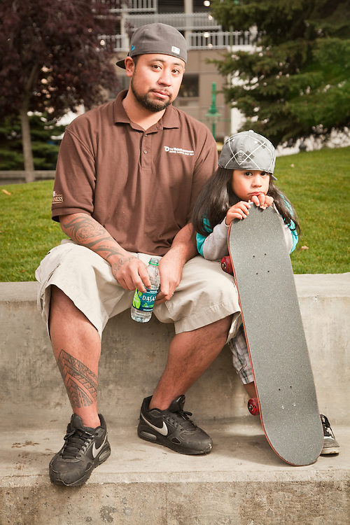 Four year old skateboarder, Sonny Young, with his father, Kilo, Town Square, Anchorage
