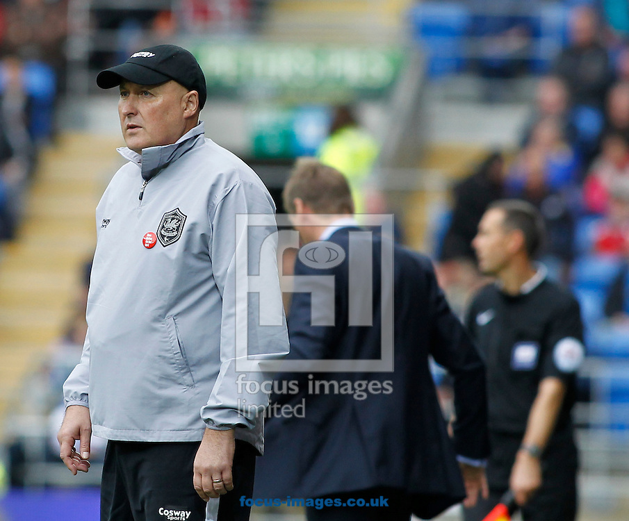 Russell Slade of Cardiff City and Stuart Pearce of Nottingham Forest during the Sky Bet Championship match at the Cardiff City Stadium, Cardiff<br /> Picture by Mike  Griffiths/Focus Images Ltd +44 7766 223933<br /> 18/10/2014