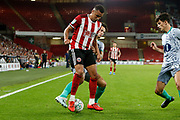 Ravel Morrison of Sheffield United is challenged by Richard Smallwood of Blackburn Rovers during the EFL Cup match between Sheffield United and Blackburn Rovers at Bramall Lane, Sheffield, England on 27 August 2019.
