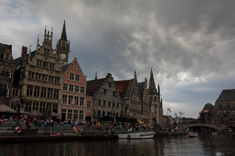 Mammatus clouds pass over the old town of Ghent, just before sunset