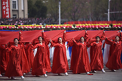 PYONGYANG, April 15, 2017  People attend a parade in central Pyongyang, April 15, 2017. The Democratic People's Republic of Korea (DPRK) Saturday showcased its military muscles by parading all of its most-advanced ballistic and tactic missiles, including a submarine-launched ballistic missile which could strike targets 1000 km away.  wtc) (Credit Image: © Cheng Dayu/Xinhua via ZUMA Wire)