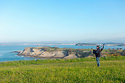 SANTANDER, SPAIN - April 19 2018 -  Person playing Cantabrian bagpipes along coastal pathway between Playa de El Sardinero beach and Faro de Cabo Mayor lighthouse in Santander, Spain, Europe.