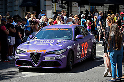 © Licensed to London News Pictures. 05/08/2018. LONDON, UK. An Alfa Romeo sets off from the start.  Gumball 3000, a charity rally for supercars and more, including celebrity entrants, begins in Covent Garden with 150 participants beginning their journey from London to Tokyo.  Photo credit: Stephen Chung/LNP