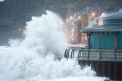 © London News Pictures. 24/12/2015. Aberystwyth, UK.  <br /> Storm Eva begins to batter the west coast of wales at Cardigan Bay in Aberystwyth on Christmas Eve. Storm Eva, the fifth named storm of the 20105/16 season, is expected to bring gales force winds gusting up to 70 or 80mph, and more heavy rain falling on already heavily saturated ground. Photo credit: Keith Morris/LNP