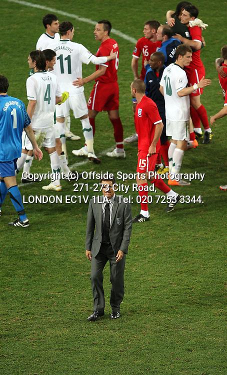 23/06/2010 World Cup. Slovenia v England.<br /> Fabio Capello walks off the pitch after congratulating his England team.<br /> Photo: Mark Leech.