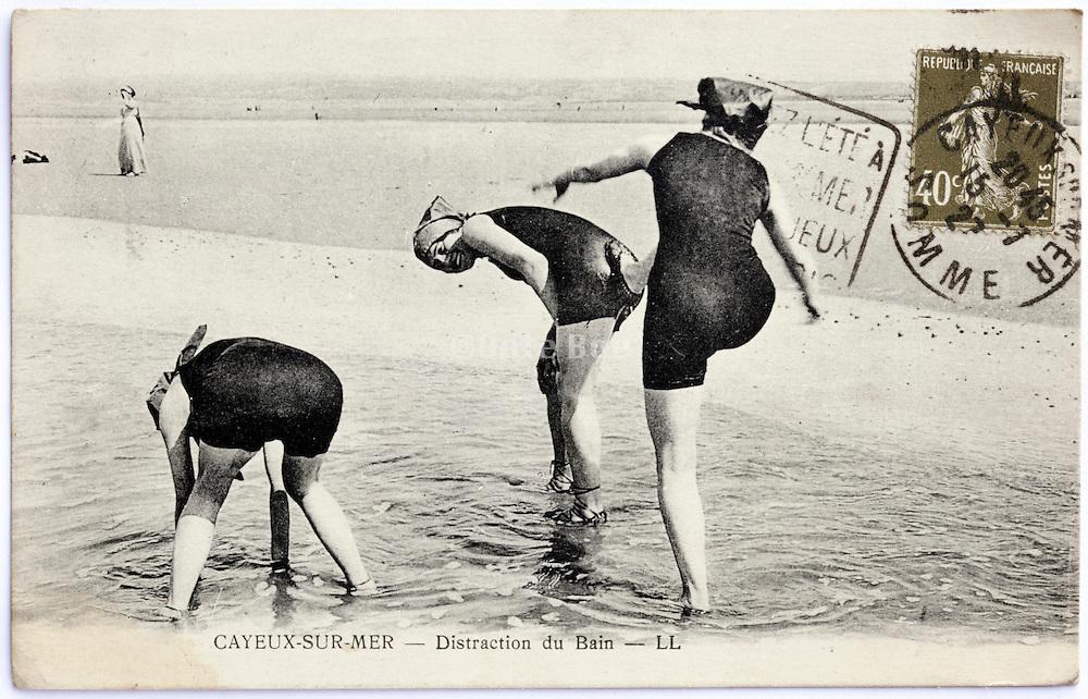 photo postcard with woman having fun playing on the beach