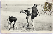 photo postcard with woman having fun playing on the beach