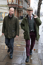 © Licensed to London News Pictures. 15/01/2018. London, UK. UKIP leader Henry Bolton (L) leaves Four Millbank in Westminster. Amid calls for his resignation, Bolton has ended his relationship with girlfriend Jo Marney after it was reported she made racist remarks about Meghan Markle. Photo credit: Rob Pinney/LNP