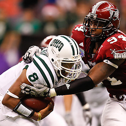 December 18, 2010; New Orleans, LA, USA; Troy Trojans defensive end Jonathan Massaquoi (94) sacks Ohio Bobcats quarterback Boo Jackson (8) during the second half of the 2010 New Orleans Bowl at the Louisiana Superdome. Troy defeated Ohio 48-21. Mandatory Credit: Derick E. Hingle