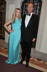 ZOE KUIPERS and MARCO WALKER at the Women for Women International UK Gala held at the Guildhall, City of London on 3rd May 2012.