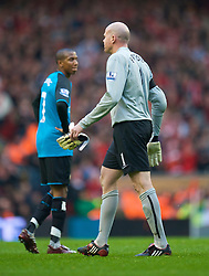 LIVERPOOL, ENGLAND - Sunday, March 22, 2009: Aston Villa's goalkeeper Brad Friedel leaves the field dejected after conceding four Liverpool goals, and then being sent off during the Premiership match at Anfield. (Photo by David Rawcliffe/Propaganda)