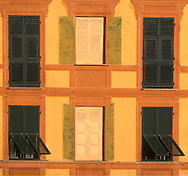 Painted and real windows on an old building in<br /> Camogli, Liguria, Italy