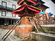 30 JULY 2015 - KATHMANDU, NEPAL:    A corner of the Jagannath Temple in Durbar Square, Kathmandu, is propped with timbers after the earthquake. The Nepal Earthquake on April 25, 2015, (also known as the Gorkha earthquake) killed more than 9,000 people and injured more than 23,000. It had a magnitude of 7.8. The epicenter was east of the district of Lamjung, and its hypocenter was at a depth of approximately 15 km (9.3 mi). It was the worst natural disaster to strike Nepal since the 1934 Nepal–Bihar earthquake. The earthquake triggered an avalanche on Mount Everest, killing at least 19. The earthquake also set off an avalanche in the Langtang valley, where 250 people were reported missing. Hundreds of thousands of people were made homeless with entire villages flattened across many districts of the country. Centuries-old buildings were destroyed at UNESCO World Heritage sites in the Kathmandu Valley, including some at the Kathmandu Durbar Square, the Patan Durbar Squar, the Bhaktapur Durbar Square, the Changu Narayan Temple and the Swayambhunath Stupa. Geophysicists and other experts had warned for decades that Nepal was vulnerable to a deadly earthquake, particularly because of its geology, urbanization, and architecture.     PHOTO BY JACK KURTZ