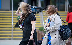© Licensed to London News Pictures. 02/10/2017. Manchester, UK. Delicates hair is blown about as they battle with strong wind on the second day of the Conservative Party Conference. The four day event is expected to focus heavily on Brexit, with the British prime minister hoping to dampen rumours of a leadership challenge. Photo credit: Ben Cawthra/LNP