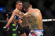 DALLAS, TX - MARCH 14:  Anthony Pettis kicks Rafael Dos Anjos during UFC 185 at the American Airlines Center on March 14, 2015 in Dallas, Texas. (Photo by Cooper Neill/Zuffa LLC/Zuffa LLC via Getty Images) *** Local Caption *** Anthony Pettis; Rafael Dos Anjos
