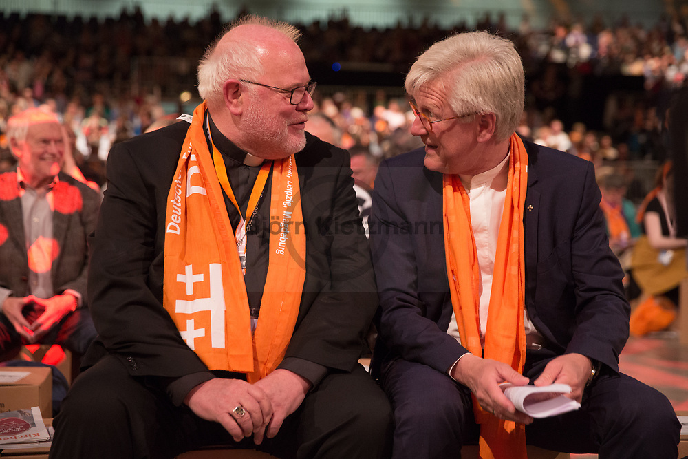 Berlin, Germany - 26.05.2017<br /> <br /> L to R: Reinhard Marx, Cardinal of the Roman Catholic Church and Chairman of the German Bishops' Conference together with the President-in-Office of the Evangelical Church in Germany, the regional bishop Heinrich Bedford-Strohm. German Protestant Church Assembly (&quot;Deutscher Evangelischer Kirchentag&rdquo;) in Berlin. <br /> <br /> L nach R: Reinhard Marx, Kardinal der r&ouml;misch-katholischen Kirche und Vorsitzender der Deutschen Bischofskonferenz zusammen mit dem Ratsvorsitzender der Evangelischen Kirche in Deutschland, der Landesbischof Heinrich Bedford-Strohm. Deutscher Evangelischer Kirchentag 2017 in Berlin. <br /> <br /> Photo: Bjoern Kietzmann