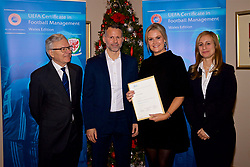 NEWPORT, WALES - Wednesday, December 12, 2018: Laura Easton receives her certificate from Wales national team manager Ryan Giggs alongside Jean-Loup Chappelet, UEFA CFM Dean (L) and Valentina Mercolli, UEFA HatTrick Programme Manager (R) during the UEFA Certificate of Football Management Graduation Ceremony in the 2010 Clubhouse at the Celtic Manor Resort. (Pic by David Rawcliffe/Propaganda)