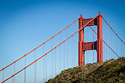 USA, California, Marin County. The Golden Gate Bridge rises above the hillside in the Marin Headlands.