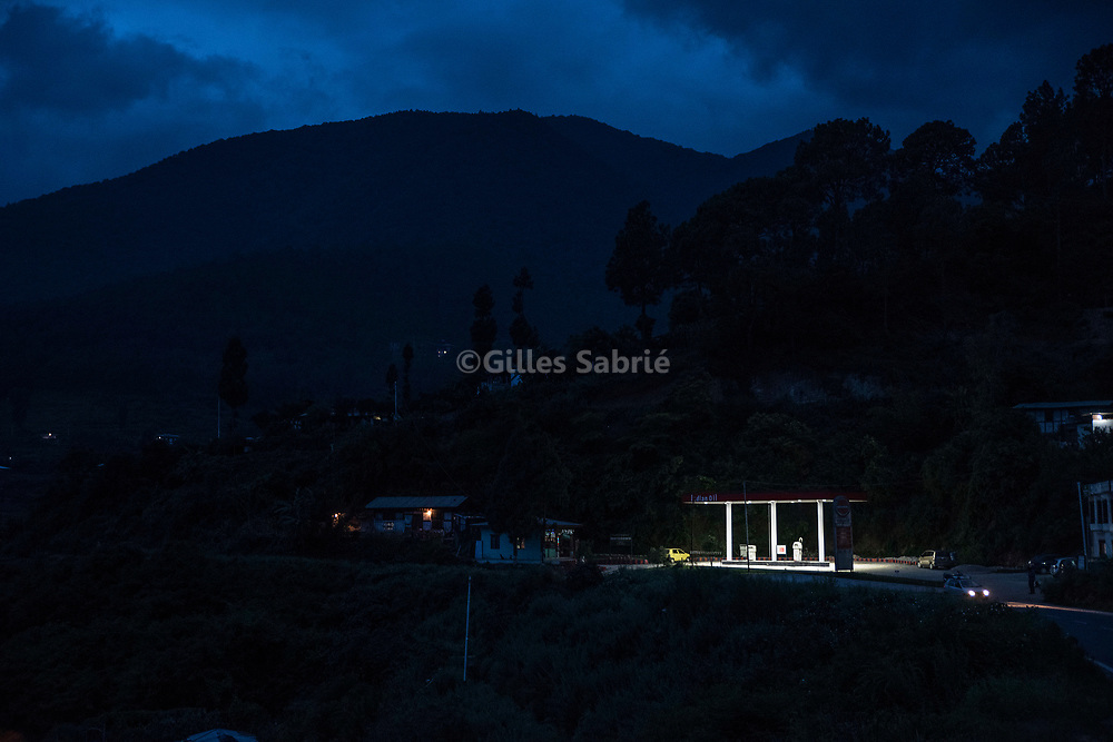 For a story by Steven Lee Myers, Bhutan<br /> Sopsokha, Bhutan, August 1st, 2017<br /> An Indian Oil gas station on a road. India is subsidising its gas and kerosene exports to Bhutan. In 2013, the Indian government put a halt to the subsidies, allegedly as a retribution for Bhutan growing closeness to China. This move contributed to the governing party defeat at the parliamentary election.<br /> Gilles Sabri&eacute; pour The New York Times