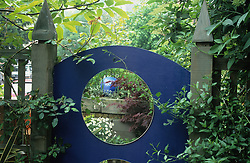 Mirror set into a trellis fence