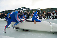 The Russian team of Alexey Gorlachev, Dmitri Elyutin, Alexey Seliverstov and Alexey Kireev compete in the Mens' four-person bobsleigh World Cup competition held at the Whistler Sliding Centre on Feb 7, 2009