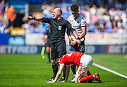Referee Scott Duncan instructs players to move back after Bolton Wanderers defender Antonee Robinson (15) fouled Nottingham Forest forward Joe Lolley (23) during the EFL Sky Bet Championship match between Bolton Wanderers and Nottingham Forest at the Macron Stadium, Bolton, England on 6 May 2018. Picture by Jon Hobley.