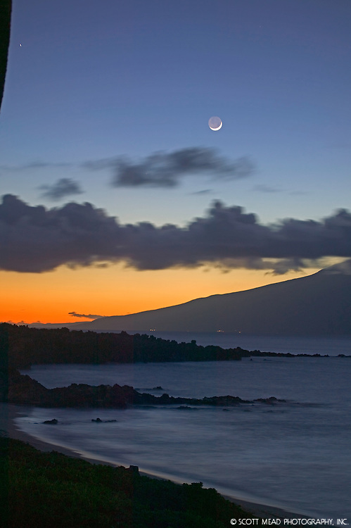 Crescent moon in twilight sky, with view of Molokai from Maui, Hawaii