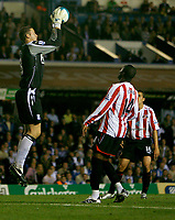 Photo: Steve Bond.<br /> Birmingham City v Sunderland. The FA Barclays Premiership. 15/08/2007. Colin Doyle (L) gathers safely as Stern John (R) closes in