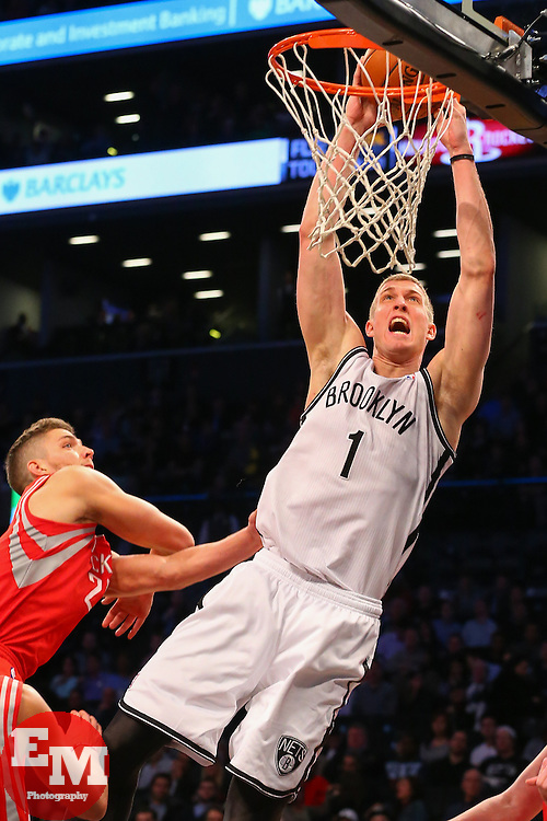 Apr 1, 2014; Brooklyn, NY, USA; Brooklyn Nets forward Mason Plumlee (1) dunks the ball during the fourth quarter at Barclays Center. The Nets defeated the Rockets 105-96.