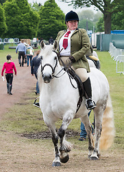 © Licensed to London News Pictures. 12/05/2018. Windsor, UK. A woman rides her horse at day 4 of the 75th Royal Windsor Horse Show . The five day event takes place in the grounds of Windsor Castle. Photo credit: Ben Cawthra/LNP